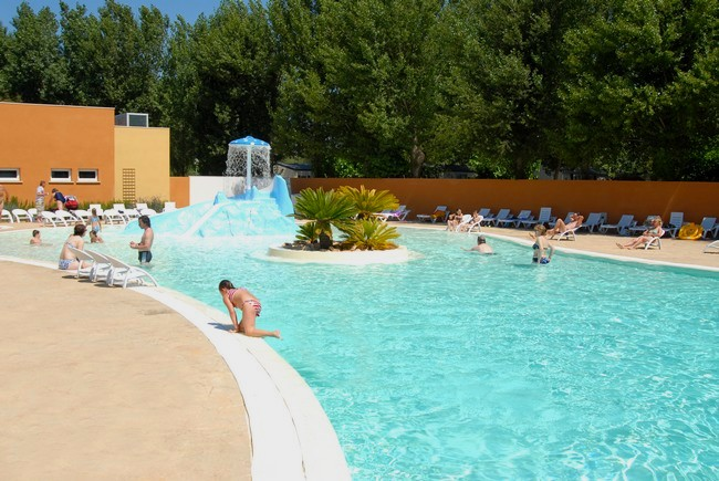 Campsite by the beach with heated outdoor swimming pool in for Heated garden swimming pools